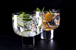 Two drinks. Two refreshing cocktails on a black background Stock Image