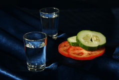 Two drinks and vegetables in the cold dark Royalty Free Stock Images