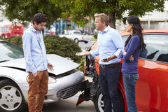 Two Drivers Arguing After Traffic Accident Royalty Free Stock Photo