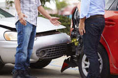 Two Drivers Arguing After Traffic Accident Stock Image