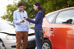 Two Drivers Exchange Insurance Details After Accident Stock Image