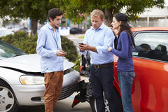 Two Drivers Exchange Insurance Details After Accident Royalty Free Stock Photography
