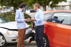 Two Drivers Exchange Insurance Details After Accident Stock Photo