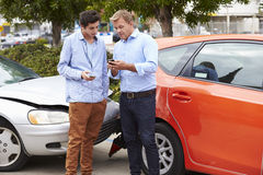 Two Drivers Exchange Insurance Details After Accident Royalty Free Stock Images