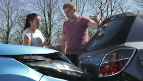 Two Drivers Exchange Insurance Details After Accident. Male and female drivers swapping insurance details using mobile phones after accident.Shot on Canon 5d Mk2 stock video