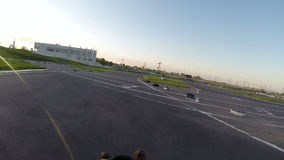 Two drivers go on karts. One driver a look back HD stock footage