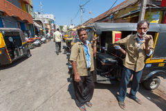 Two drivers of traditional indian taxi autorickshaw waiting for customers Royalty Free Stock Photo