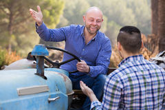 Two drivers working with tractor Stock Photos