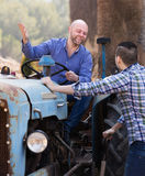 Two drivers working with tractor Stock Images