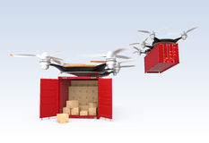 Two drone carrying cargo containers Stock Photo