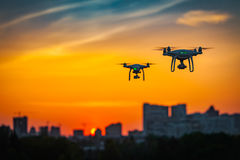 Two drone quad copters with high resolution digital camera flying stock images