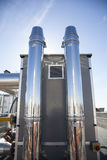 Two bright metal ducts. Two ducts of the cooling system on top of a building Stock Image