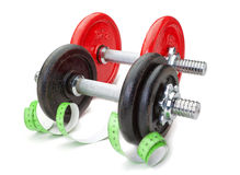 Two dumbbells for fitness and measuring meter. Royalty Free Stock Images