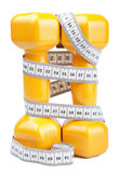 Two dumbbells and measuring tape isolated Royalty Free Stock Image