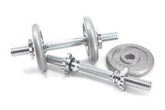 Two Dumbbells and plate Stock Images