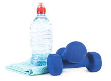 Two dumbells, water in bottle and towe Royalty Free Stock Photo