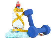 Two dumbells, water in bottle and towel Royalty Free Stock Photo