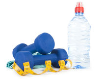 Two dumbells, water in bottle and towel Stock Photography