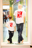Two dummies in symbolizing discount shirts Stock Photography