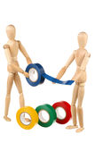 Two dummy and adhesive tape Stock Images