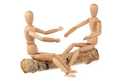 Two dummy and the log Royalty Free Stock Image