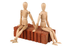 Two dummy and red brick Stock Image