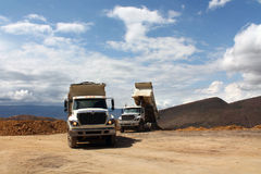 Two dump truck. Working on the mountain Royalty Free Stock Photography