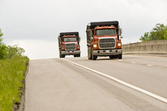 Two Dump Trucks On Highway Royalty Free Stock Images
