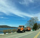 Two Dump Trucks By The Lake Stock Photos
