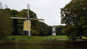 Two Dutch grain wind mills Royalty Free Stock Photos