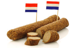 Two Dutch snacks called fricandel. With Dutch flag toothpicks and some cut pieces on a white background stock photos