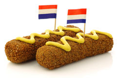 Two Dutch snacks called kroket with mustard royalty free stock photos