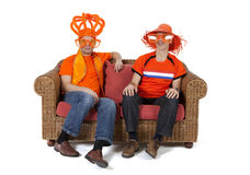 Two Dutch soccer fan watching game over white background Royalty Free Stock Photo