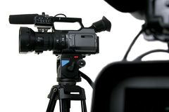 Two dv-camcorders. Two black dv camcorders stay with white background Royalty Free Stock Photography