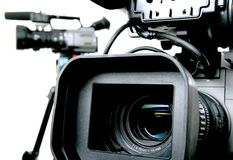 Two dv-camcorders. Two black dv camcorders stay with white background Stock Photography
