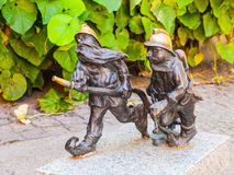 Two dwarf firemen figurines in Wroclaw Royalty Free Stock Image