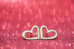 Two earring on the floor with bokeh background.  stock photo