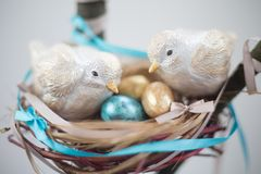 Two easter birds on nest with eggs royalty free stock images