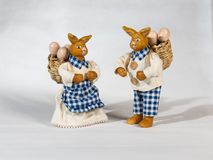 Two easter bunnies with baskets and eggs. Two easter bunnies with baskets and easter eggs. The happy rabbits talk to each other Stock Images