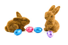 Two easter bunnies with easter eggs. Isolated on white background Stock Image