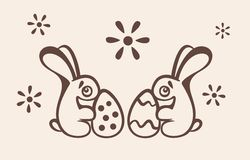 Two Easter Bunnies keep eggs Royalty Free Stock Photos
