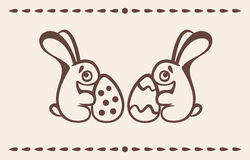 Two Easter Bunnies keep eggs Stock Photography