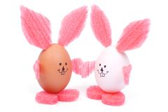 Two Easter bunny with pink ears holding Stock Photography