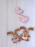 Two Easter Bunny and two pink birds cookies Stock Photography