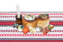 Two Easter cake, several different Easter eggs, candle on tablec Royalty Free Stock Image