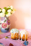 Two easter cakes on pink towel. And hydrangea bouquet in vase on background Stock Images