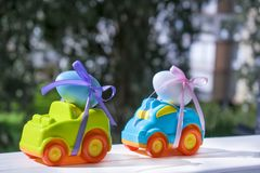 Two Easter cars with a eggs. Two Easter cars tied up with colored ribbons go on the table on the background of greenery stock photography