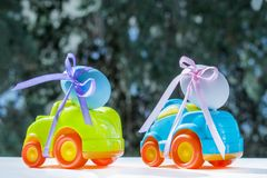 Two Easter cars. Tied up with colored ribbons go on the table on the background of greenery stock image