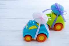 Two Easter cars with a eggs. Two Easter cars tied up with colored ribbons go on the table royalty free stock photography