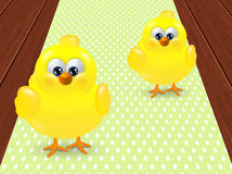 Two easter chicks standing on dotted tablecloth Royalty Free Stock Images